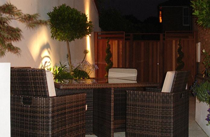 Chic courtyard garden at night