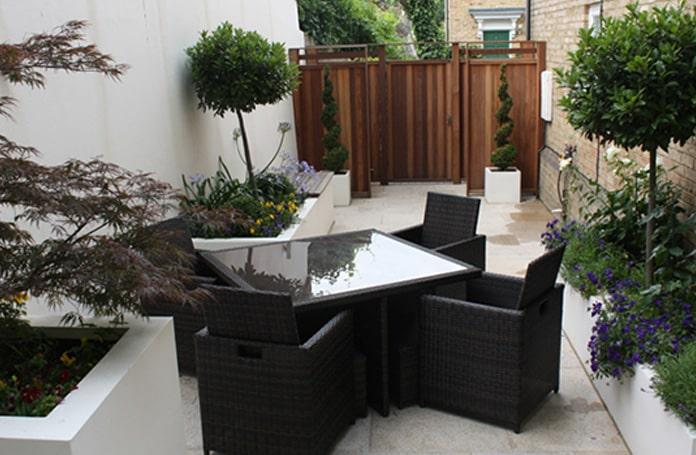 Chic courtyard garden with bin store